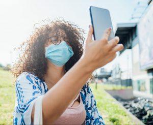 Woman wearing mask taking a selfie