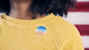 I voted sticker on sweater